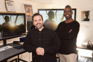 "<em>Agustin ""Auggie"" Reach, assistant editor, left, and James Wilcox, editor,</em> Night Two."