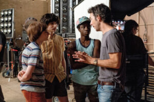 "Noah Schnapp, Finn Wolfhard, Caleb McLaughlin, Shawn Levy on the ""Stanger Things"" set."